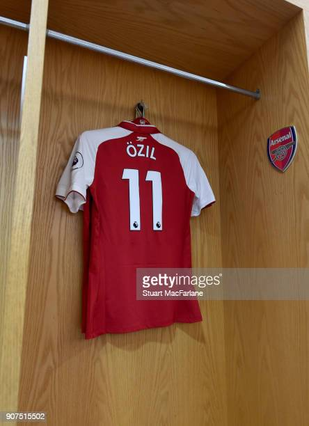 Mesut Ozil's Arsenal shirt hangs in the home changing room before the Premier League match between Arsenal and Crystal Palace at Emirates Stadium on...