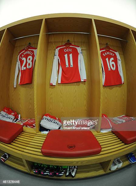 Mesut Ozil's shirt hangs in the Arsenal changing room before the Barclays Premier League match between Arsenal and Stoke City at Emirates Stadium on...