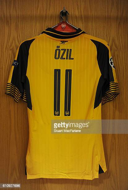 Mesut Ozil's shirt hangs in the Arsenal changing room before the UEFA Champions League match between Arsenal FC and FC Basel 1893 at Emirates Stadium...