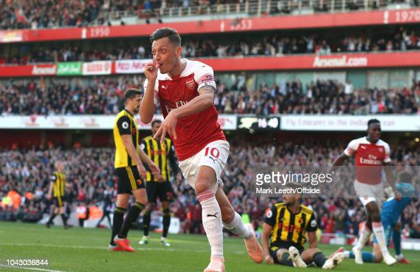 Mesut Özil of Arsenal celebrates after scoring the second goal during the Premier League match between Arsenal FC and Watford FC at Emirates Stadium...