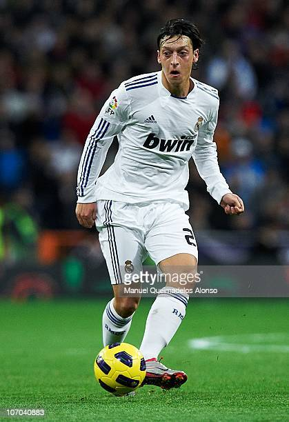 Mesut zil of Real Madrid in action during the La Liga match between Real Madrid and Athletic Bilbao at Estadio Santiago Bernabeu on November 20 2010...