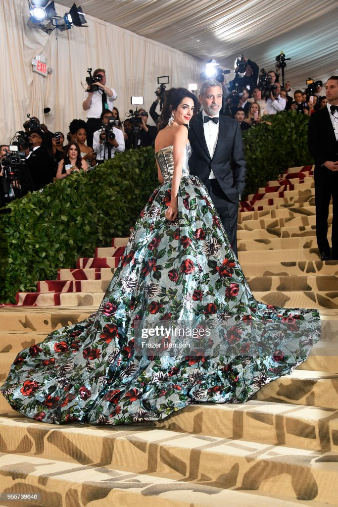 Met Gala co-host Amal Clooney and George Clooney attend the Heavenly Bodies: Fashion & The Catholic Imagination Costume Institute Gala at The Metropolitan Museum of Art on May 7, 2018 in New York City.