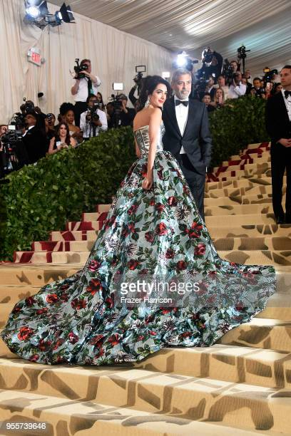 Met Gala cohost Amal Clooney and George Clooney attend the Heavenly Bodies Fashion The Catholic Imagination Costume Institute Gala at The...