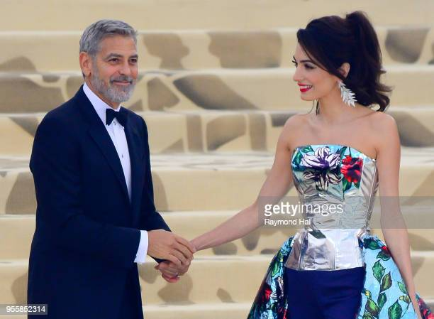 Met Gala co-host Amal Clooney and George Clooney attend the Heavenly Bodies: Fashion & The Catholic Imagination Costume Institute Gala at The...