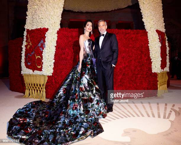 Met Gala Host Amal Clooney and George Clooney attend Heavenly Bodies Fashion The Catholic Imagination Costume Institute Gala at The Metropolitan...