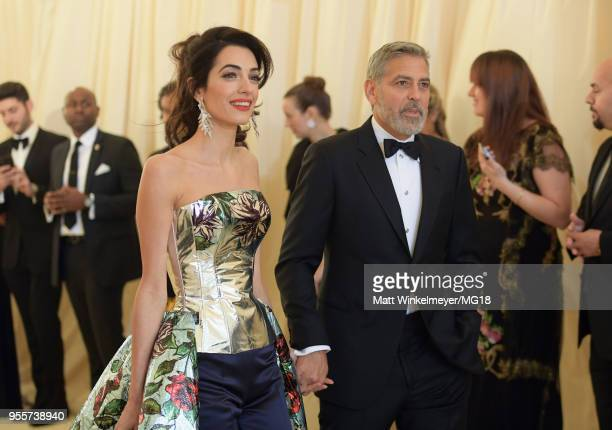 Met Gala Host Amal Clooney and George Clooney attend the Heavenly Bodies: Fashion & The Catholic Imagination Costume Institute Gala at The...