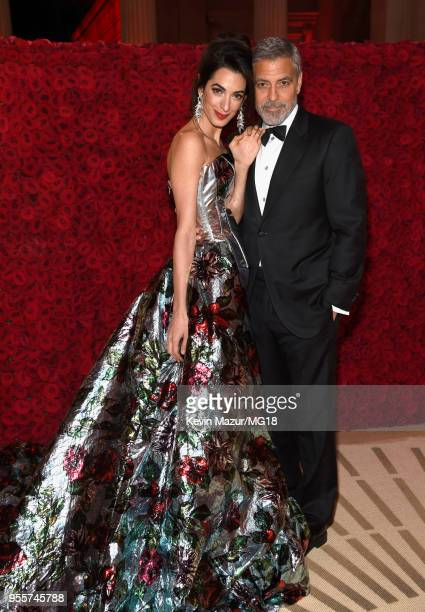 Met Gala Host Amal Clooney and George Clooney attend the Heavenly Bodies Fashion The Catholic Imagination Costume Institute Gala at The Metropolitan...