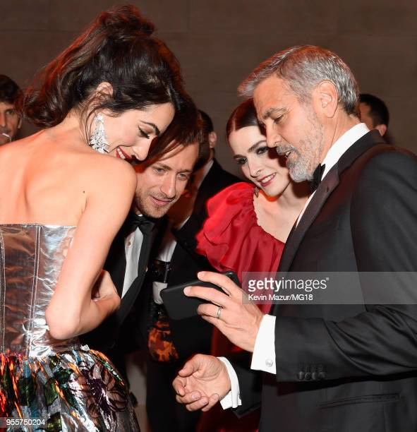 Met Gala Host Amal Clooney Francesco Carrozzini Bee Shaffer and George Clooney attend the Heavenly Bodies Fashion The Catholic Imagination Costume...