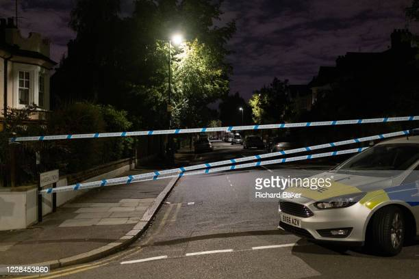 Met Police car blocks local roads surrounding Herne Hill and Carnegie Library in Lambeth, after two people were reported shot in a nearby residential...