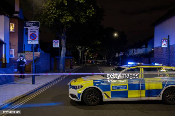Met Police officer at the closed-off roads surrounding Herne Hill and Carnegie Library in Lambeth, after two people were reported shot in this...