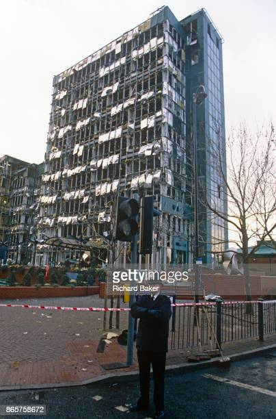 Met police officer stands at the scene of the IRA bombing in London Docklands, detonated by Irish Republicans and resulting in the deaths of two...