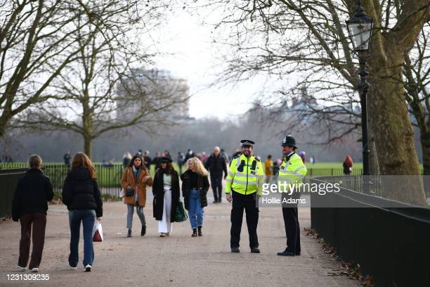 Met police officers patrol as people exercise in Hyde Park on February 21, 2021 in London, England. The British government is expected to announce...