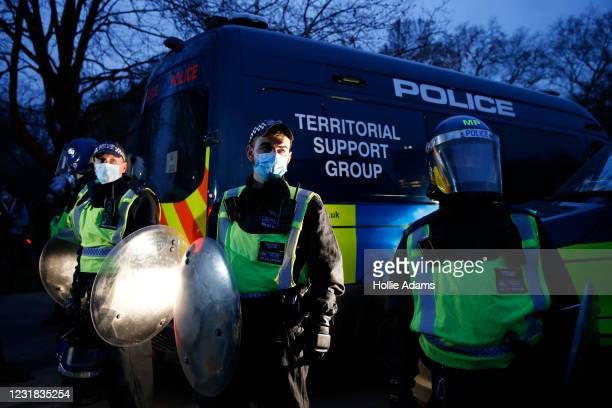 """Met Police stand beside a Territorial Support Group Vehicle during a """"World Wide Rally For Freedom"""" protest on March 20, 2021 in London, England...."""