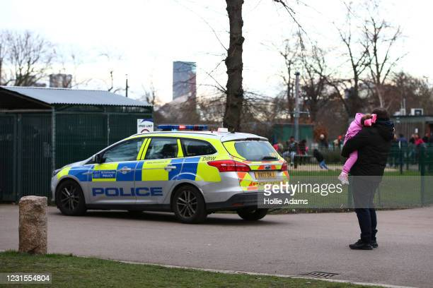 Met Police vehicle parked near Victoria Park playground on March 6, 2021 in London, England. Londoners are enjoying bright weather as end of lockdown...