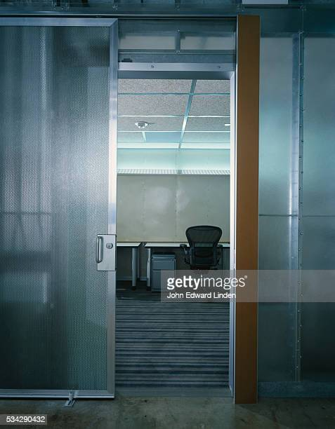 Metal and Glass Sliding Panels to Office in Nexspace Office Building