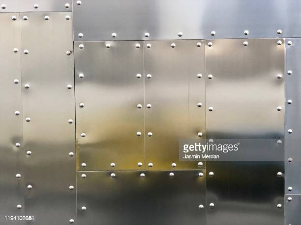 metal background with screws - metallic stock pictures, royalty-free photos & images
