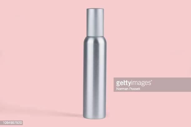 metal bottle against pink background - 蓋 ストックフォトと画像
