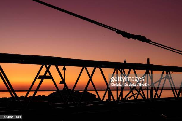 metal bridge against sky during sunset - christian soldatke imagens e fotografias de stock