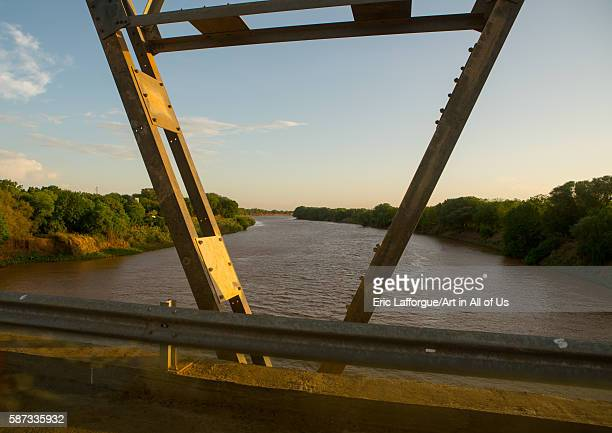 Metal bridge being built by chinese workers above omo river omo valley omorate Ethiopia on March 16 2016 in Omorate Ethiopia