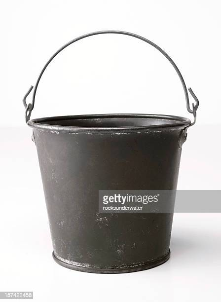 Metal bucket with an upright handle on a blank background