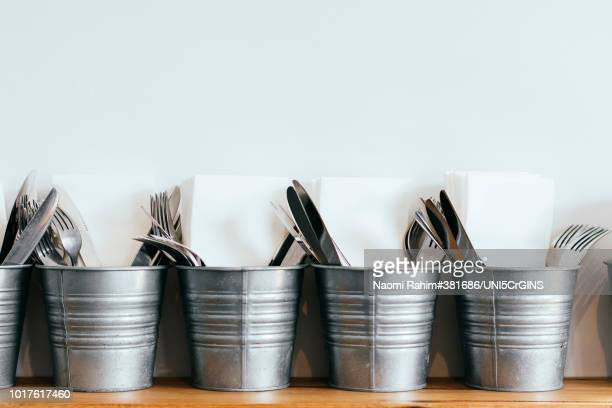 metal buckets holding knives, forks and napkins - silverware stock pictures, royalty-free photos & images
