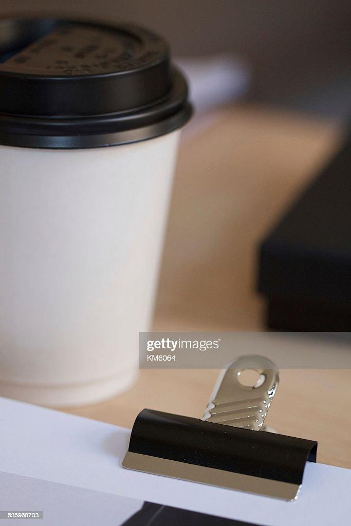 Metal Bulldog clip holding paperwork : Stock Photo