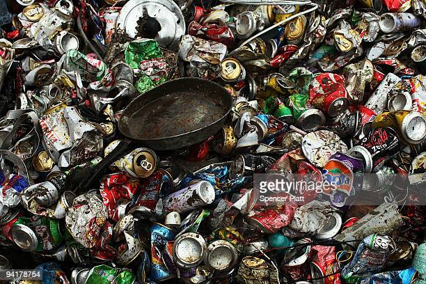 Metal cans and other objects are piled to be recycled at the Jardim Gramacho waste disposal site on December 9 2009 in Jardim Gramacho Brazil...