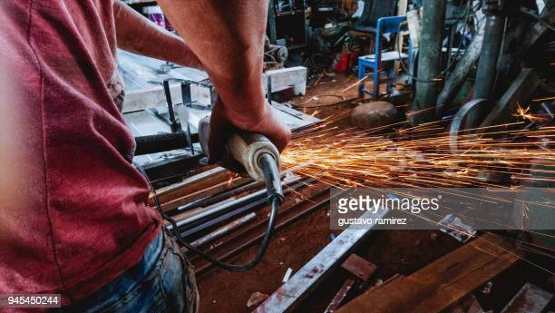 metal carpenter welding - fabricage apparatuur stock pictures, royalty-free photos & images