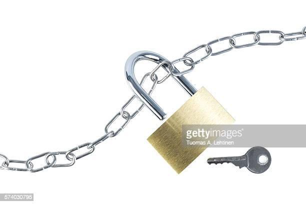 Metal chain, unlocked padlock and a key