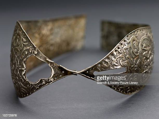 Metal chastity belt 15th to 16th century Metal chastity belt consisting of two panels hinged together richly decorated 15th16th century Grey...