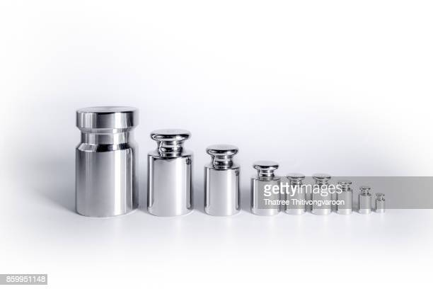 metal chrome exact weight on white background - weight stock pictures, royalty-free photos & images