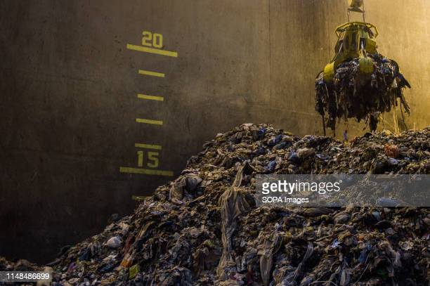 A metal claw grabs non recyclable waste before transporting it to the incinerator at a Thermal Waste Recycling Facility in Gdansk The first Polish...