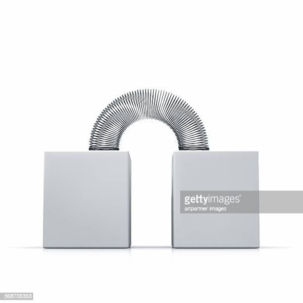 metal coil or slinky toy - metal coil toy stock photos and pictures