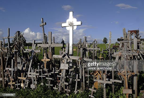 A metal cross reflects the sun on the 'Hill of Crosses' in Northern Lithuanian national at the pilgrimage site near the city of Siauliai on September...