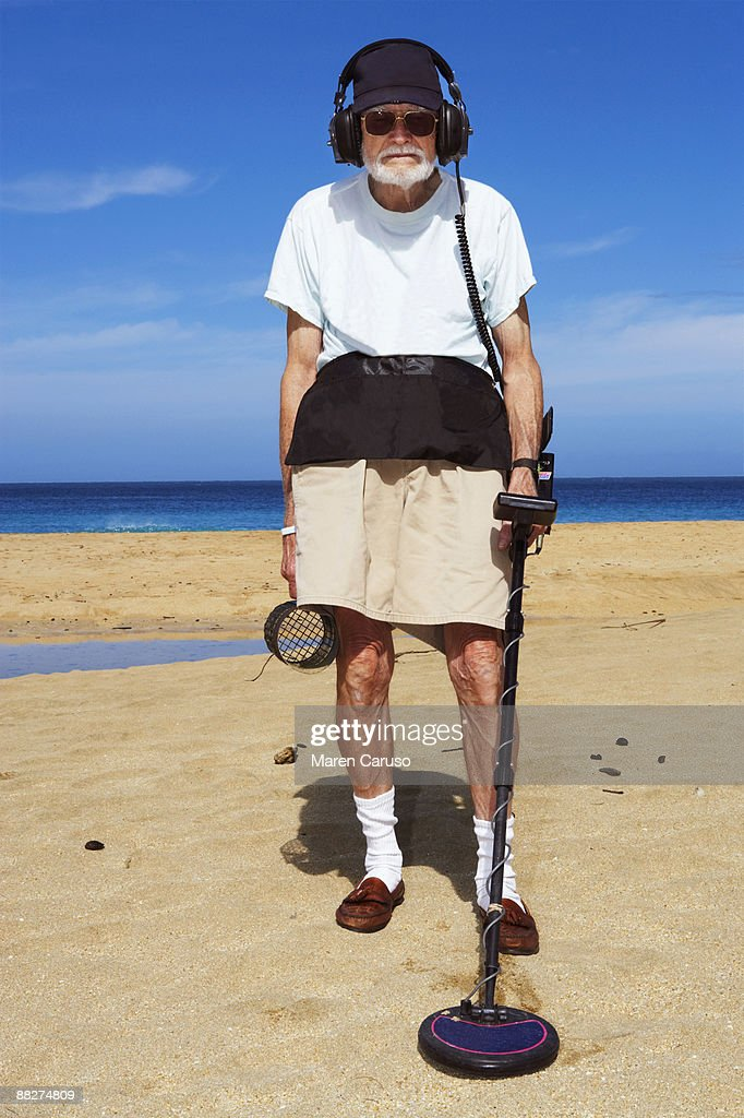 Jew Detector: Metal Detector Man On The Beach Stock Photo