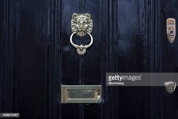 A metal door knocker letter box and locks sit on the front door of a residential property on Egerton Crescent in London UK on Tuesday Dec 31 2013...