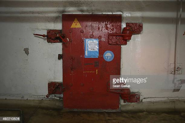 A metal door with a sign warning of radiation stands at the wall separating reactors three and four inside the former Chernobyl nuclear power plant...