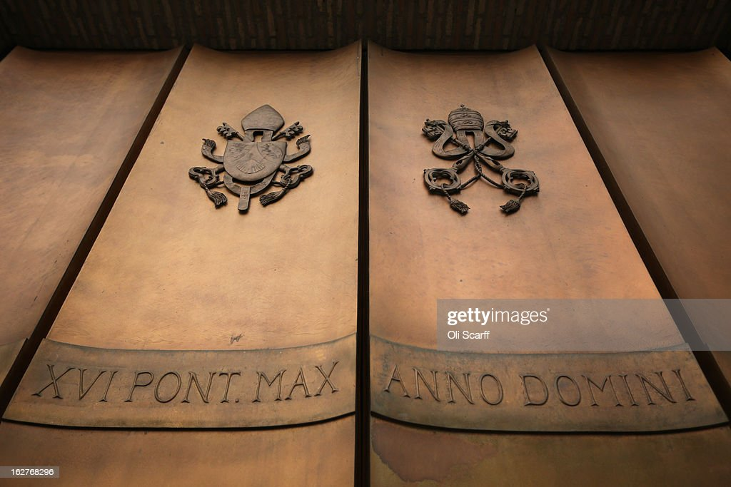 Metal doors bearing the Papal Seal at the entrance to the Vatican City ahead of Pope Benedict XVI's last public audience on February 26, 2013 in Vatican City, Vatican. The Pontiff will hold his last weekly public audience on February 27, 2013 before he retires the following day. Pope Benedict XVI has been the leader of the Catholic Church for eight years and is the first Pope to retire since 1415. He cites ailing health as his reason for retirement and will spend the rest of his life in solitude away from public engagements.