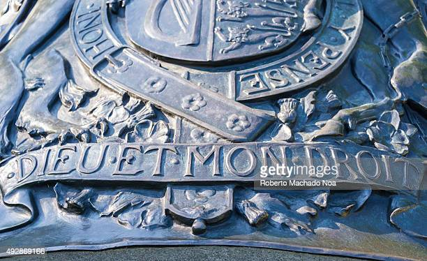 Metal emblem of the Royal coat of arms of the United Kingdom having the motto Dieu et Mon Droit Dieu et Mon Droit is the motto of the Monarch of the...