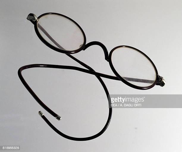 Metal eyeglasses with temple arms known as curly arms covered in celluloid from the early 1900s 20th century