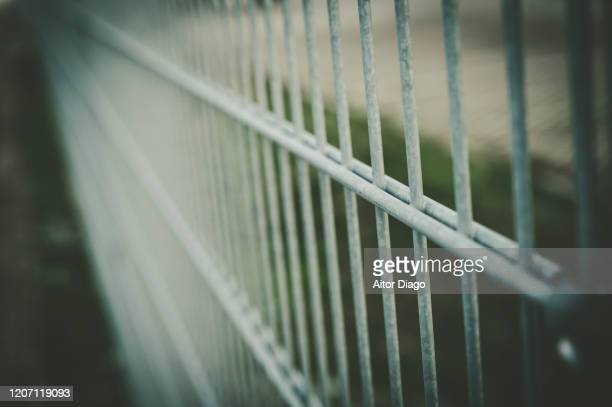 metal fence. retro style. - metallic stock pictures, royalty-free photos & images