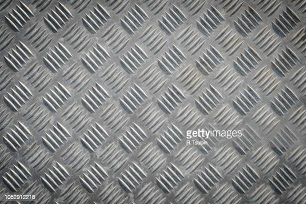 metal floor plate with diamond pattern texture for background - chrome stock photos and pictures