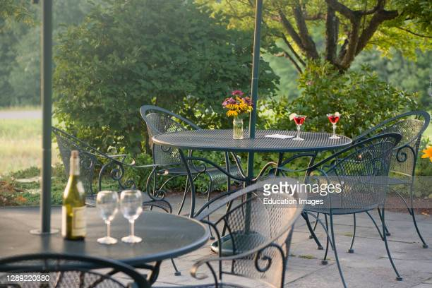 Metal garden furniture on patio with drinks, Chesterfield Inn, New Hampshire, USA.