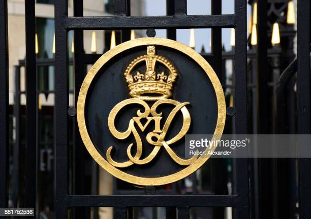 A metal gate near the Tower of London in London England includes a royal crown and 'GR VI' which stands for George Rex the Sixth or King George VI...