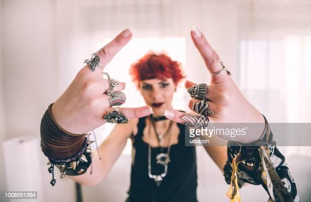 Metal girl showing devil horns gesture