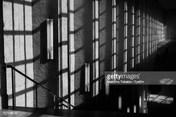 metal grate in sunlight - prison bars stock pictures, royalty-free photos & images