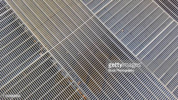 metal grate on sidewalk - metal grate ストックフォトと画像