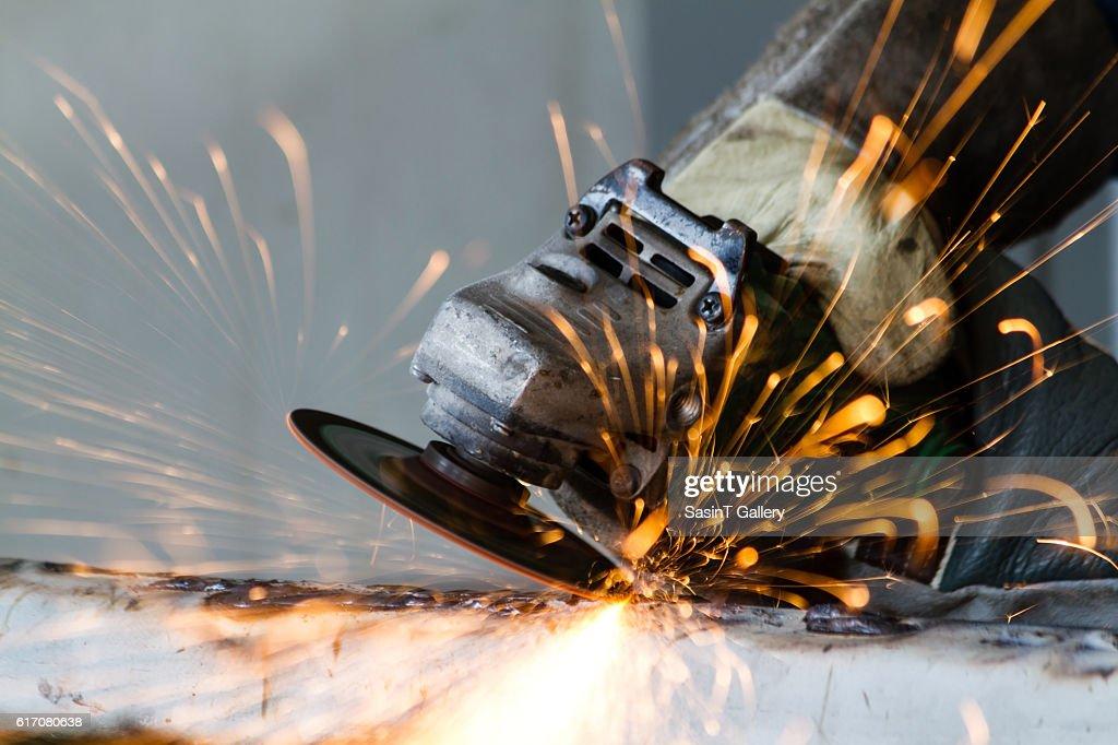 Metal grinding on steel pipe : Stock Photo