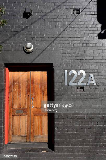 Metal house numbers are mounted on the exterior of a house in Brunswick, a northern suburb of Melbourne, Australia, on Monday, June 28, 2010. A...