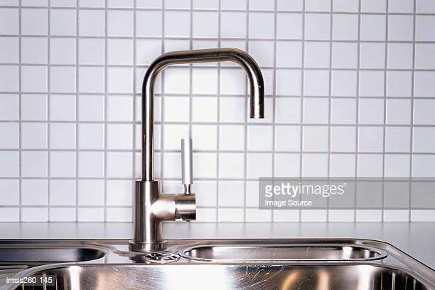 metal kitchen sink - kitchen sink stock pictures, royalty-free photos & images